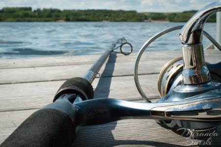 A fishing rod on the edge of a dock