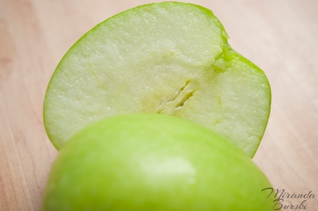 A green apple cut in half