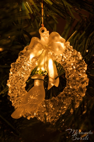 A Christmas decoration featuring a bird on a wreath