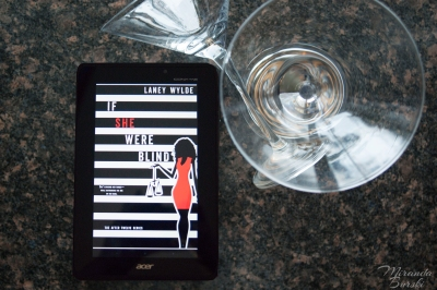 An ebook copy of If She Were Blind, by Laney Wylde, beside two martini glasses