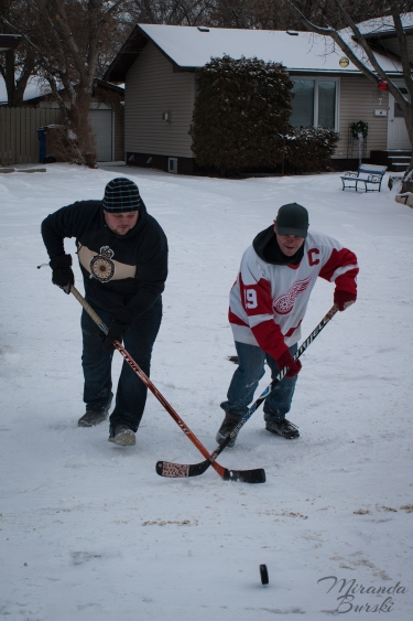 Two players trying to beat each other to a hockey puck