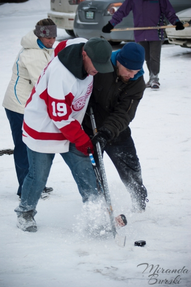 Two players fighting over a hockey puck