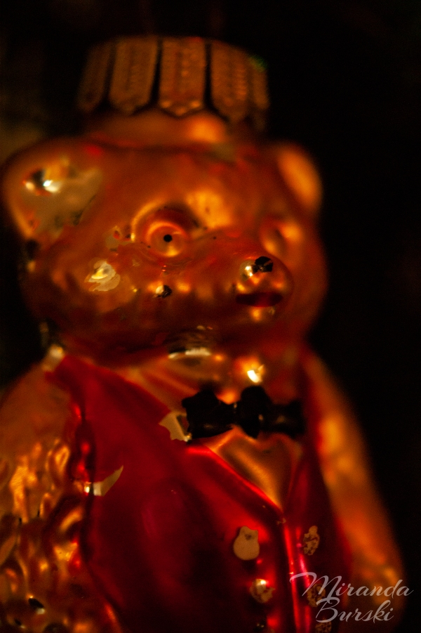 A glass Christmas ornament, shaped like a bear