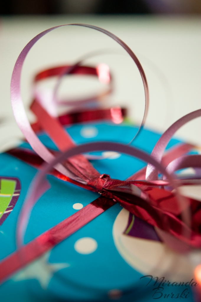 Curled red ribbon on a wrapped Christmas present