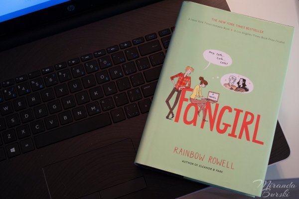 A copy of Fangirl, by Rainbow Rowell, sitting on a laptop keyboard.