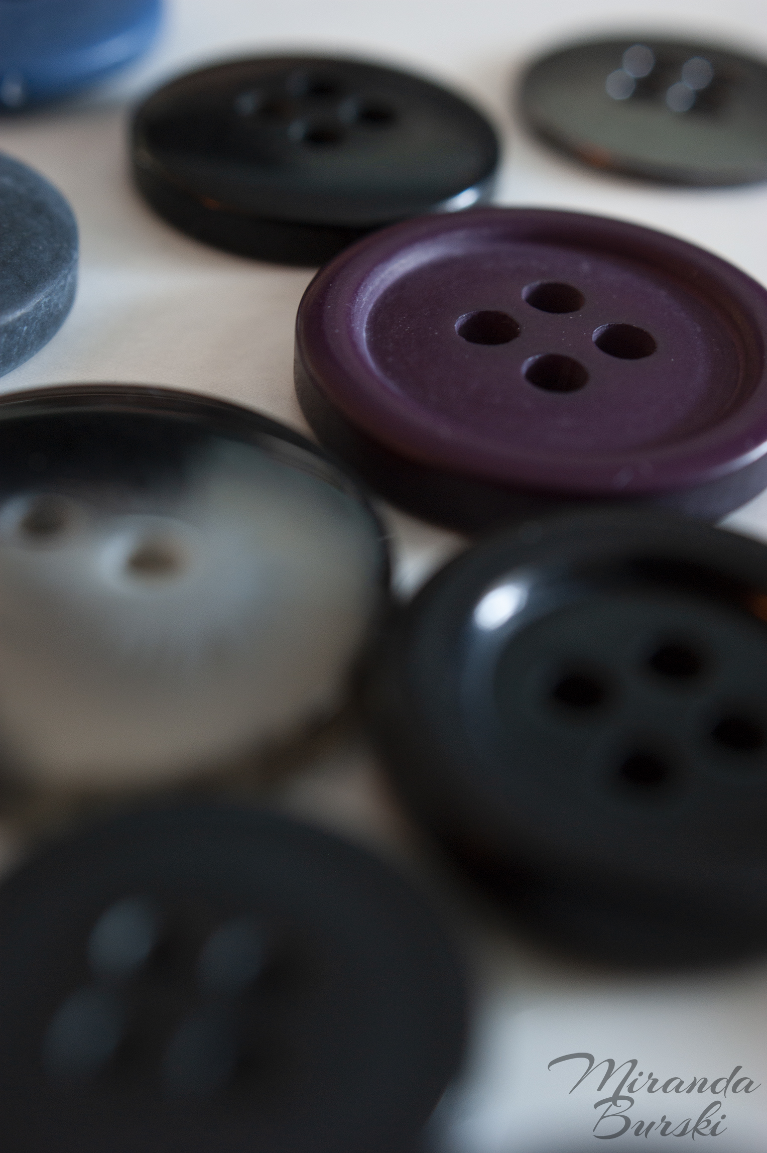 A collection of buttons of various colours.