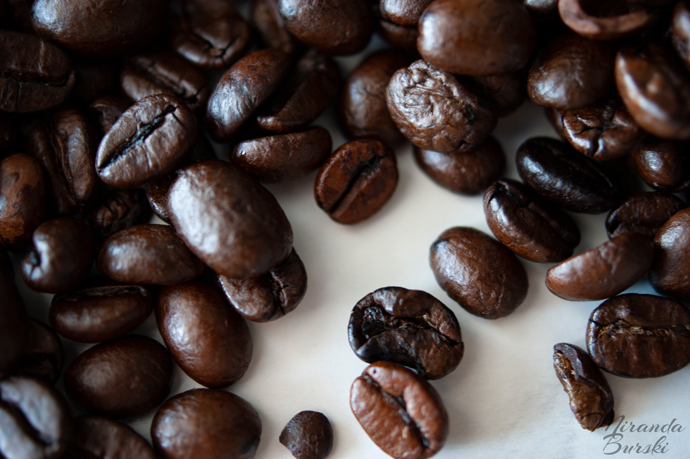 A collection of coffee beans on a white background.