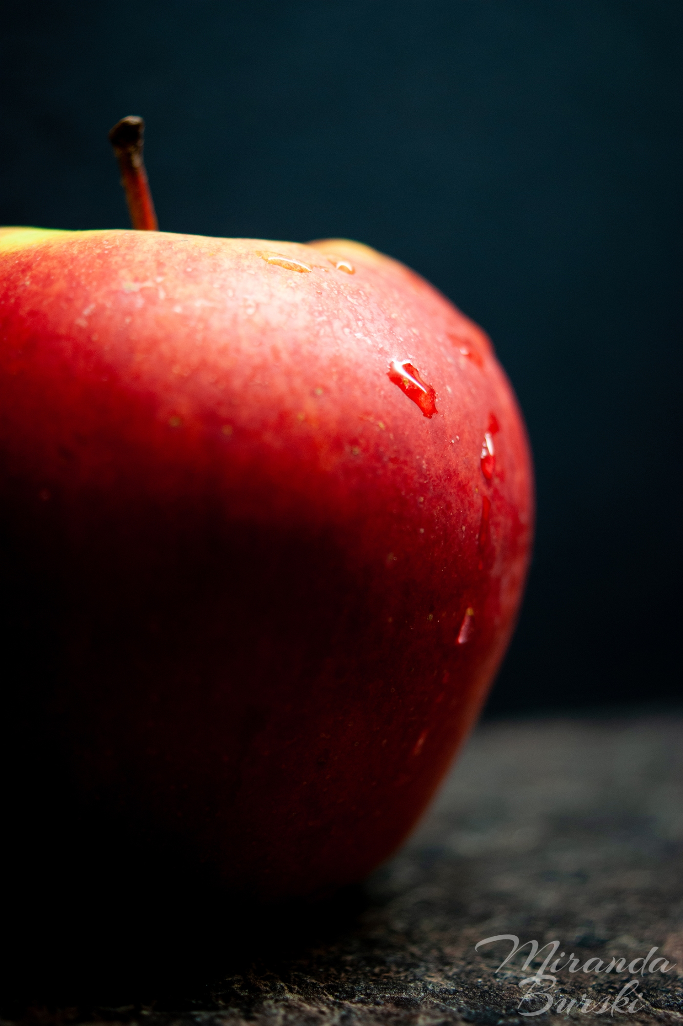 An apple on a black background.