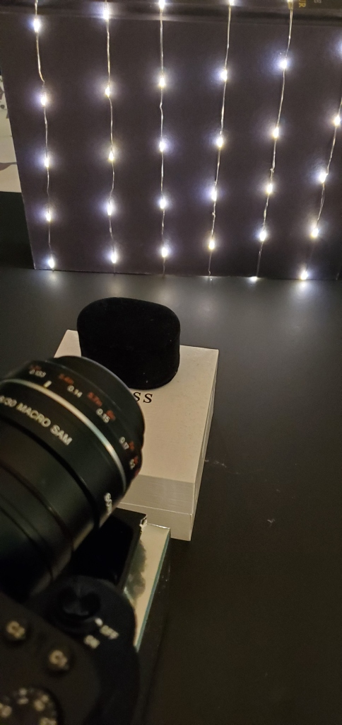 A camera set up with a homemade light background