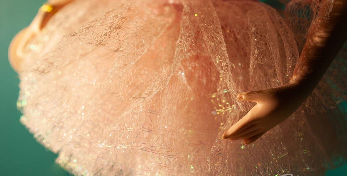 A close-up of the skirt on a porcelain ballerina.