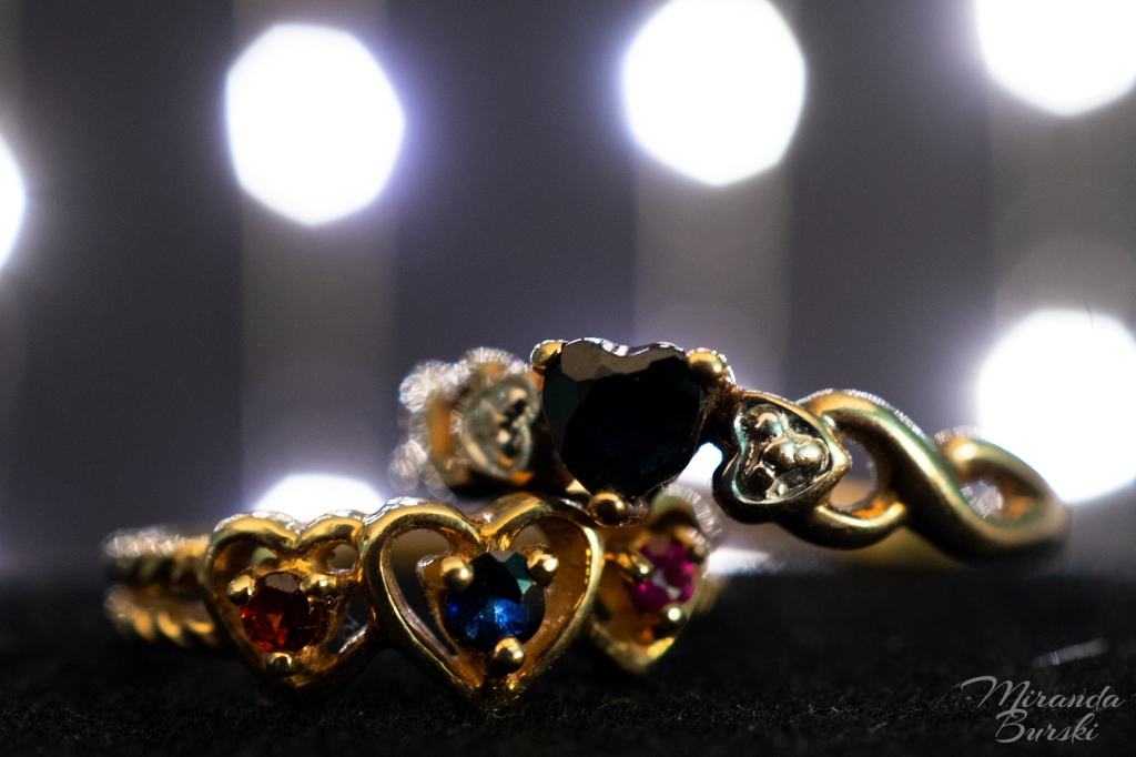 Two gold rings with sapphires and other gems