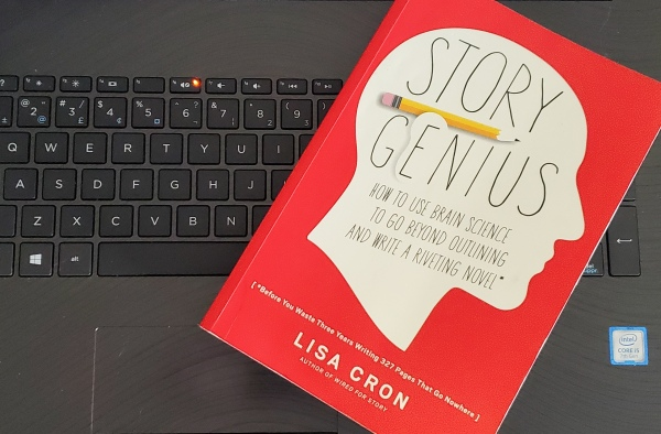 Story Genius, by Lisa Cron, on a laptop keyboard.