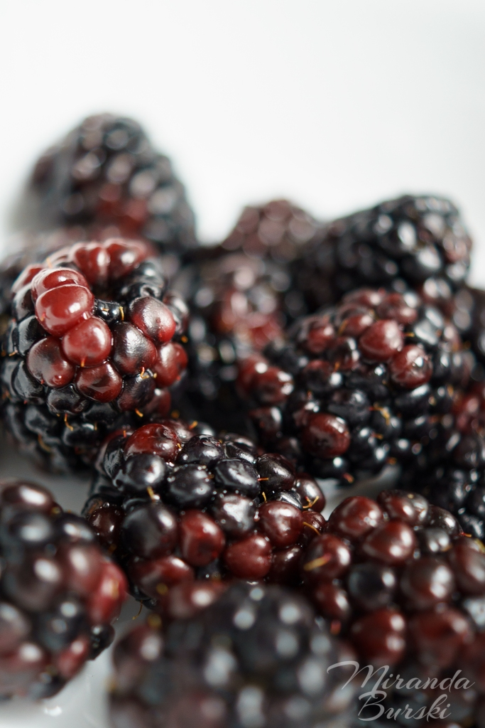 A close-up of freshly washed blackberries.